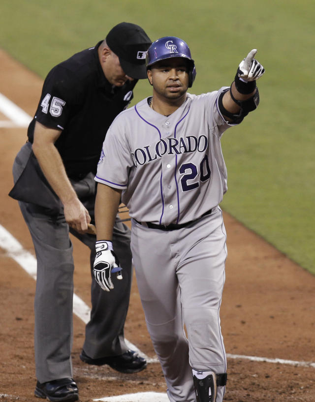 Colorado Rockies' Willin Rosario celebrates after hitting a home run in the third inning against the Philadelphia Phillies in a baseball game, Tuesday, Aug. 20, 2013, in Philadelphia. (AP Photo/Laurence Kesterson)