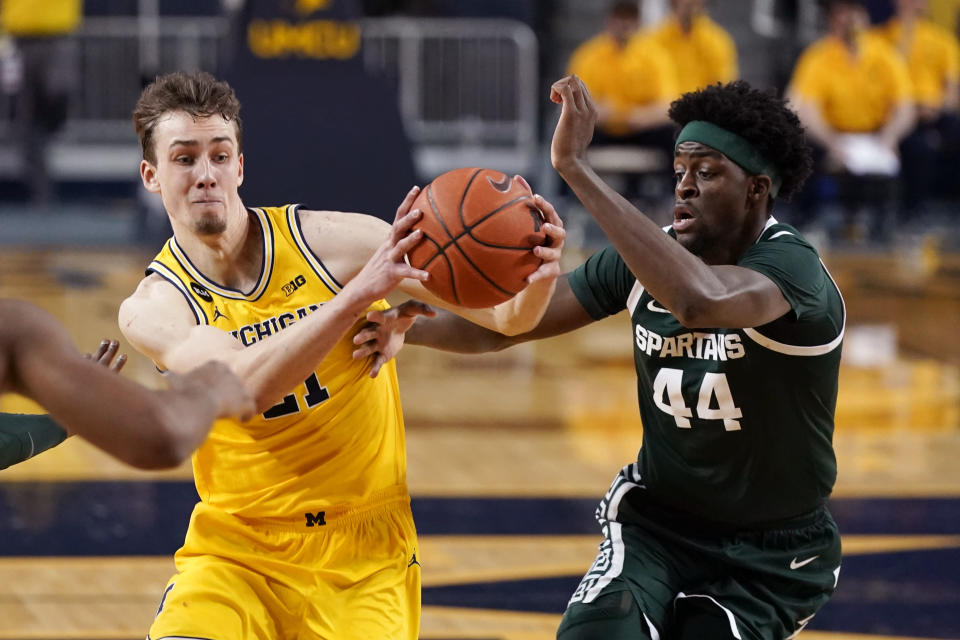 Michigan guard Franz Wagner (21) drives as Michigan State forward Gabe Brown (44) defends during the first half of an NCAA college basketball game Thursday, March 4, 2021, in Ann Arbor, Mich. (AP Photo/Carlos Osorio)
