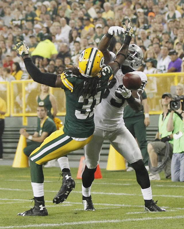 Green Bay Packers' Davon House breaks up a pass intended for Oakland Raiders' James Jones during the first half of an NFL preseason football game Friday, Aug. 22, 2014, in Green Bay, Wis. (AP Photo/Mike Roemer)