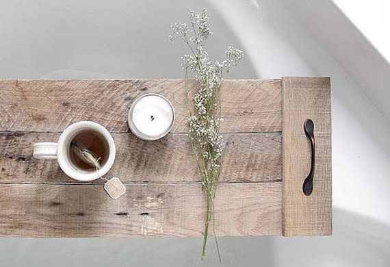 """<a href=""""https://www.etsy.com/shop/FernwehReclaimedWood"""" target=""""_blank"""">Fernweh Reclaimed Wood</a> is one of several shops on Etsy that specializes in unique, handmade wooden decor like <a href=""""https://www.etsy.com/listing/523402507/bath-tray-reclaimed-wood-spa-tray-gift?ref=shop_home_active_18"""" target=""""_blank"""">this wooden bath tray</a>."""