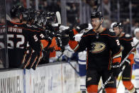 Anaheim Ducks' Carter Rowney, right, celebrates his goal with teammates during the first period of an NHL hockey game against the Toronto Maple Leafs Friday, March 6, 2020, in Anaheim, Calif. (AP Photo/Marcio Jose Sanchez)