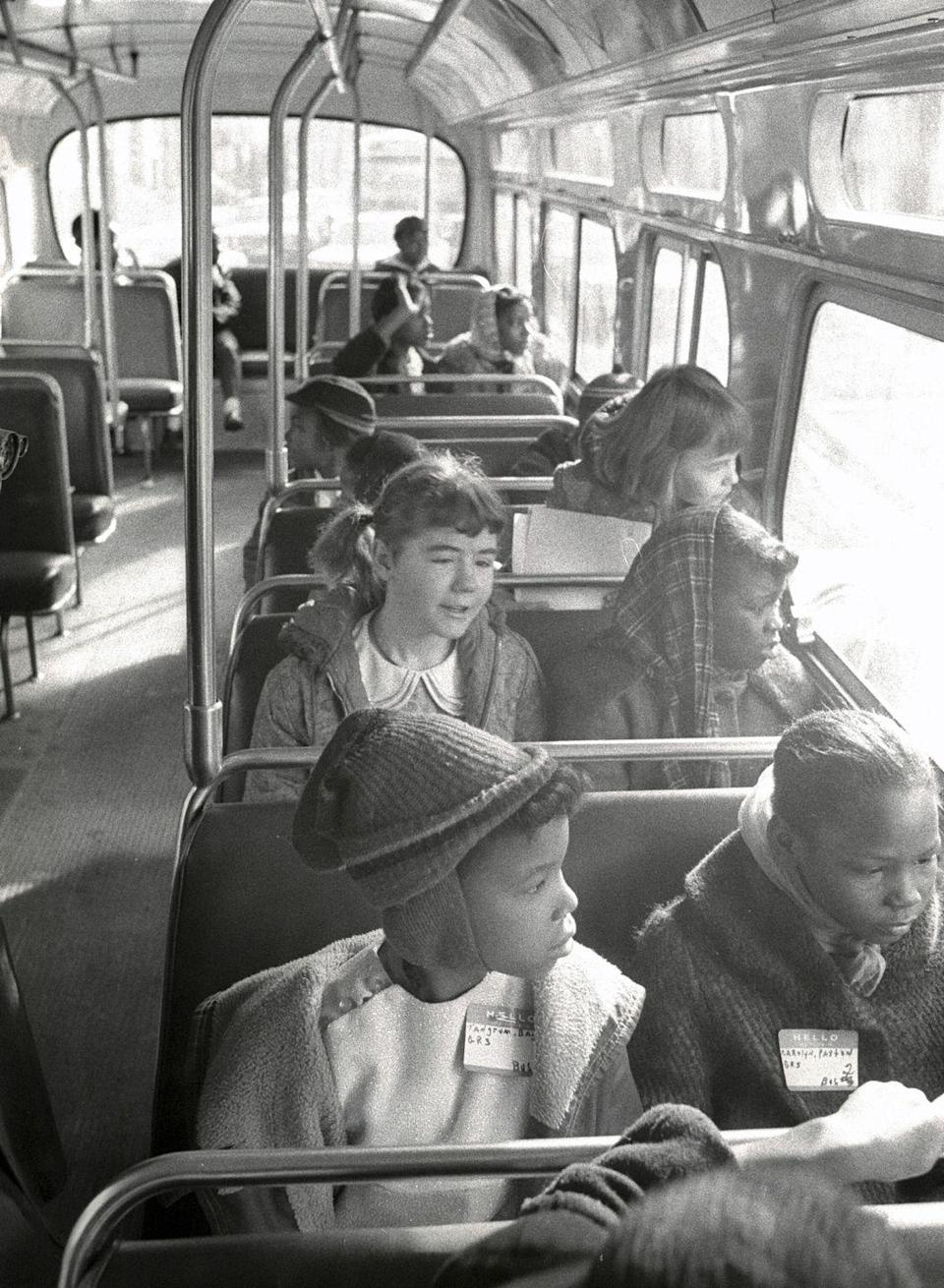 <p>Kids chat with one another on the school bus together.</p>