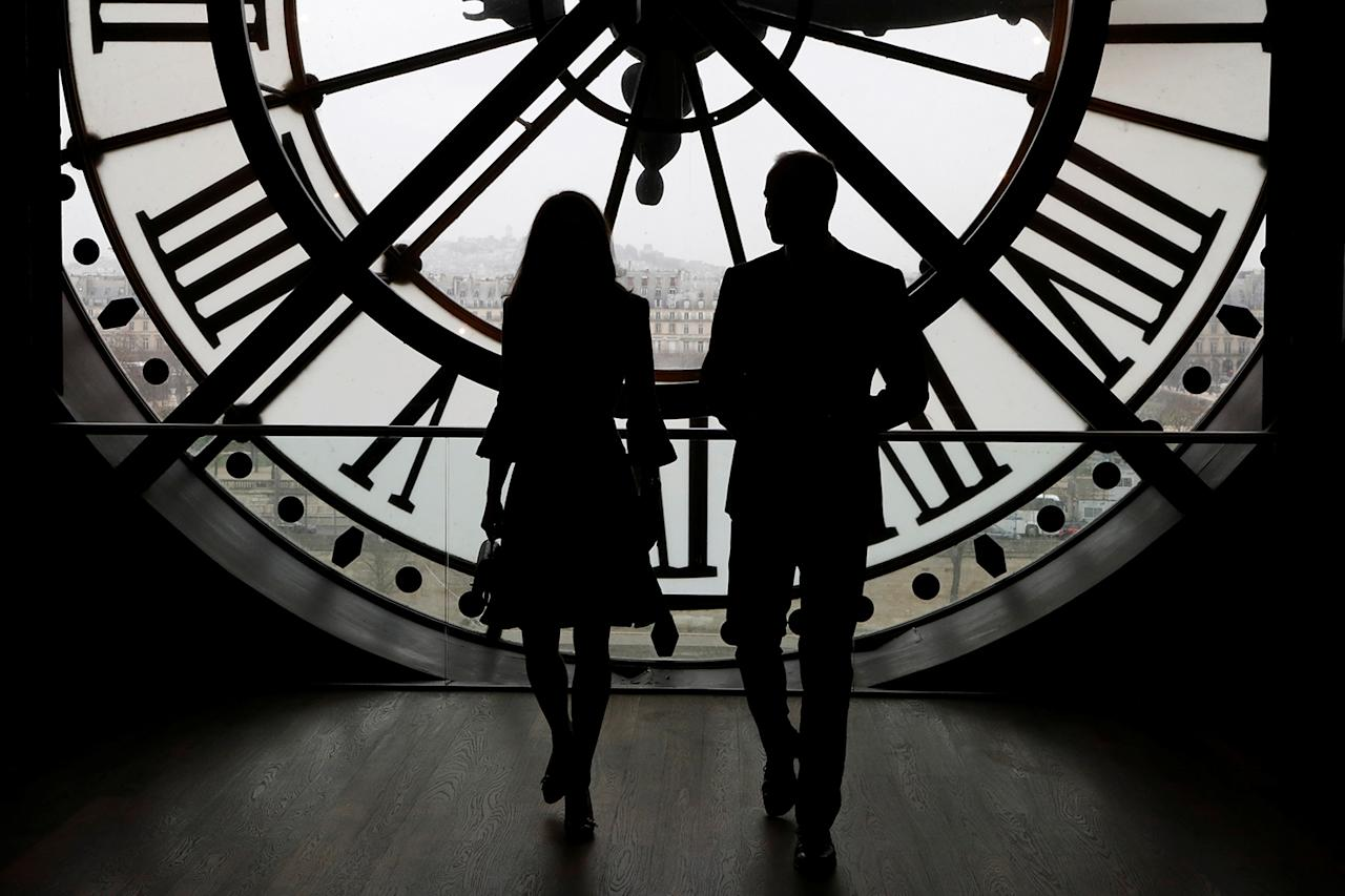 <p>Britain's Prince William, Duke of Cambridge, and his wife Britain's Catherine the Duchess of Cambridge look across the River Seine through the clock face at the Musee díOrsay, the former Gare d'Orsay train station, during their visit to the museum in Paris, France March 18, 2017. (Photo: Francois Guillot/Reuters) </p>