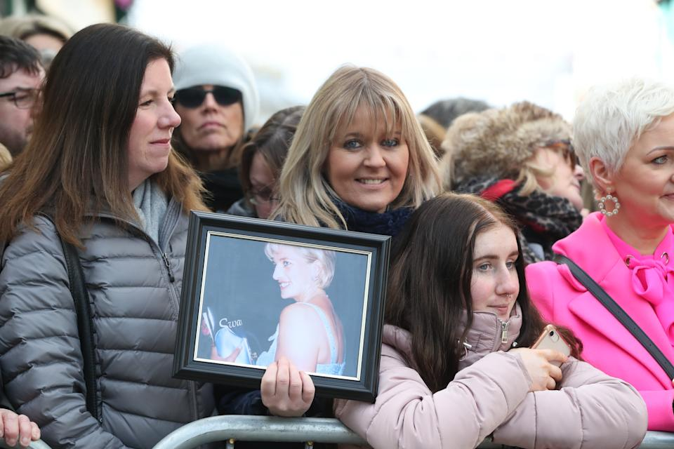 Michelle Rogers, from Co Laois, holding a picture of the Princess of Wales as she awaits the arrival of the Duke and Duchess of Cambridge for a visit to a traditional Irish pub in Galway city centre during the third day of their visit to the Republic of Ireland. (Photo by Niall Carson/PA Images via Getty Images)