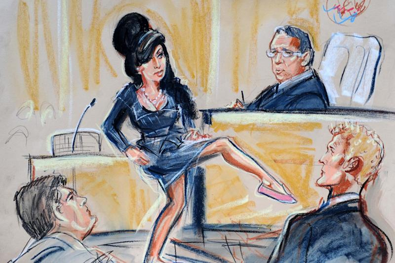 """In 2009, Amy Winehouse was accused of assaulting a fan and ultimately acquitted—after the singer, just 5'3"""" in her ballet flats, stood up to remind the judge of her small stature and stand by her claim that she only could have been defending herself."""