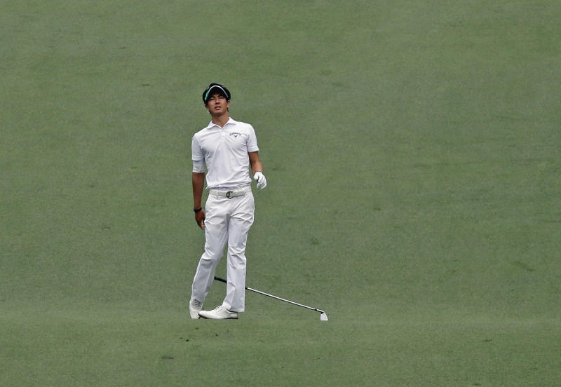 Ryo Ishikawa, of Japan, reacts his second shot on the seventh hole during the fourth round of the Masters golf tournament Sunday, April 14, 2013, in Augusta, Ga. (AP Photo/David J. Phillip)