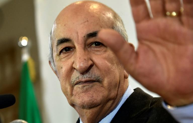 Algerian President Abdelmadjid Tebboune, seen in this December 2019, is hospitalised in Germany where he has received unspecified treatment according to his office