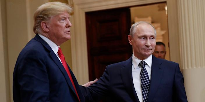 U.S. President Donald Trump, left, and Russian President Vladimir Putin, right, leave the stage together at the conclusion of their joint news conference at the Presidential Palace in Helsinki, Finland, Monday, July 16, 2018.