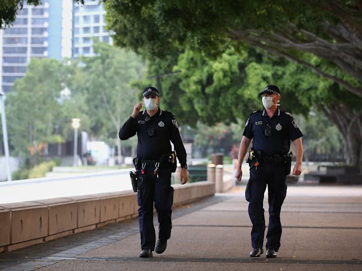 Police officers patrol in Brisbane (Getty Images)