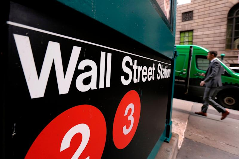 FILE- In this April 5, 2018, file photo, a sign for a Wall Street subway station is shown in New York. The U.S. stock market opens at 9:30 a.m. EDT on Tuesday, May 29. (AP Photo/Richard Drew, File)