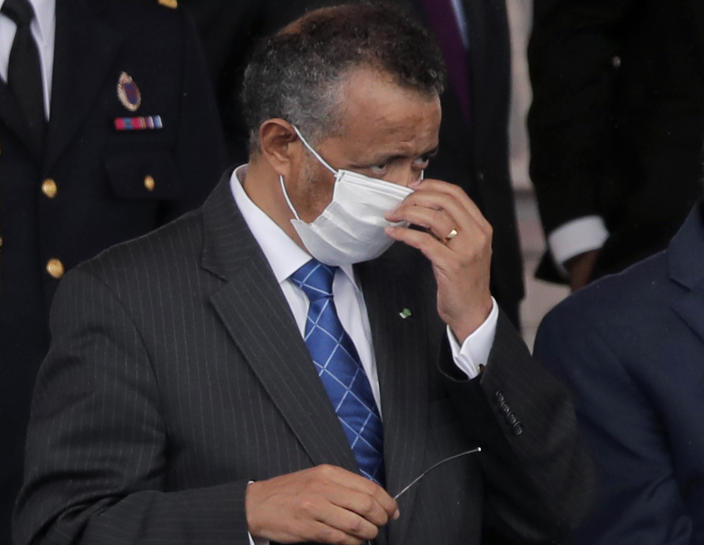FILE - In this file photo dated Tuesday, July 14, 2020, Director General of the World Health Organization, Tedros Adhanom Ghebreyesus, adjusts his face mask during the Bastille Day military parade, in Paris. France. More than 20 heads of government and global agencies have called for an international treaty for pandemic preparedness and response, that they say will protect future generations from future pandemics, with WHO's Tedros Adhanom Ghebreyesus and other leaders calling for countries to act cooperatively. (AP Photo/Christophe Ena, FILE)