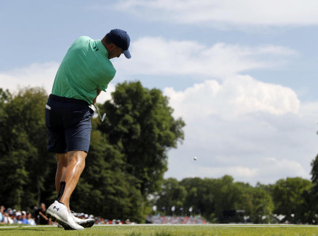 Jordan Spieth hits on the 16th tee during a practice round for the PGA Championship golf tournament at Bellerive Country Club, Wednesday, Aug. 8, 2018, in St. Louis. (AP Photo/Jeff Roberson)
