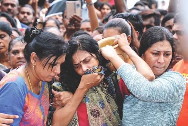 D. Shanti (centre) was inconsolable while performing a ritual for her son Nhaveen during his funeral on Friday. — Bernama pic