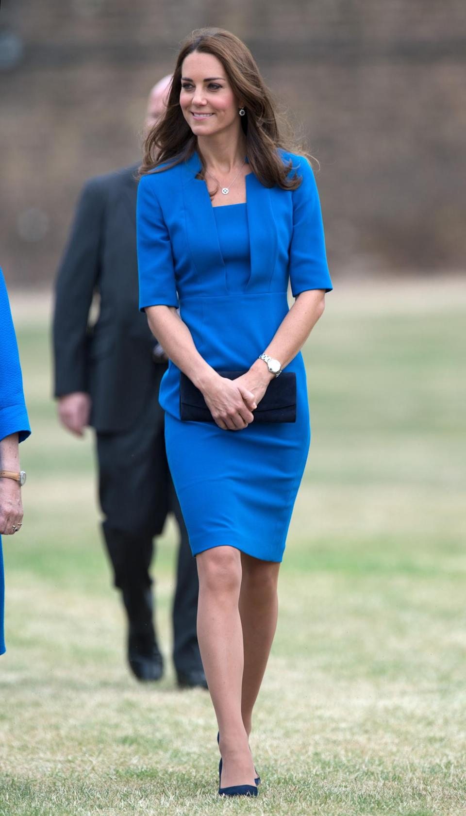 <p>Kate visited the Tower of London in a bright blue dress by L.K. Bennett and navy suede Jimmy Choos. The Duchess accessorised with a Stuart Weitzman clutch.</p><p><i>[Photo: PA]</i></p>