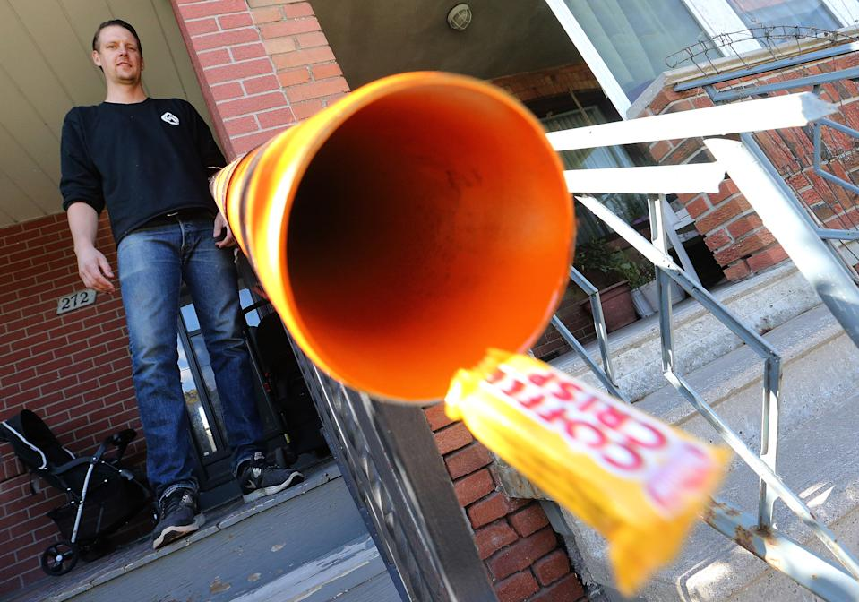 Geoff Burke is behind an initiative with the Daily Bread Food Bank to install candy chutes in front of people's porches so kids can trick-or-treat without so much as jeopardizing their health and safety during COVID-19 in Toronto on October 16, 2020. (Steve Russell/Toronto Star via Getty Images)