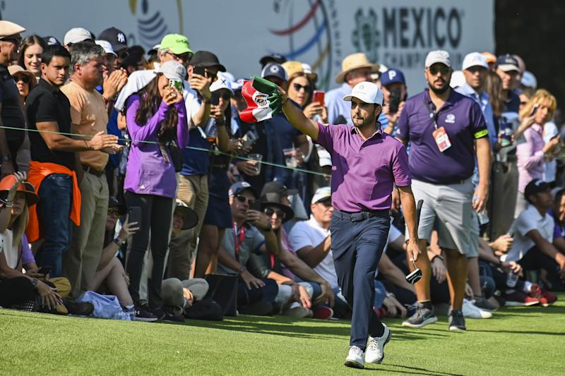 MEXICO CITY, MEXICO - FEBRUARY 22: Abraham Ancer of Mexico smiles as he waves a Mexican flag to fans as he walks on the 17th hole during the third round of the World Golf Championships-Mexico Championship at Club de Golf Chapultepec on February 22, 2020 in Mexico City, Mexico. (Photo by Keyur Khamar/PGA TOUR via Getty Images)