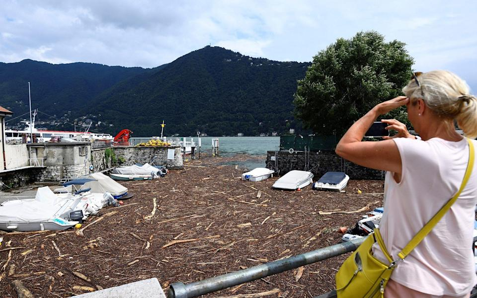 Trees and debris clog up the shores of Lake Como after heavy rain caused flooding - FLAVIO LO SCALZO /REUTERS