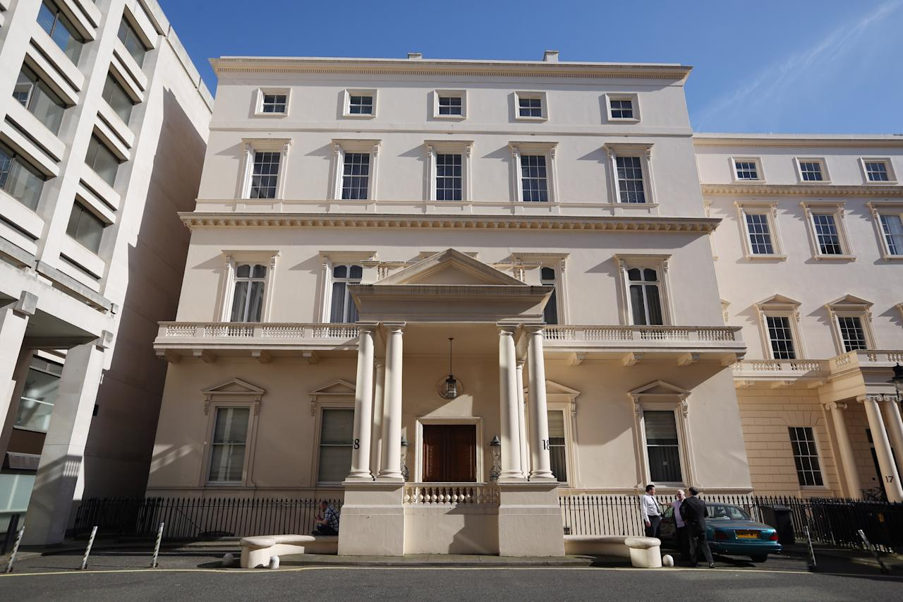 LONDON, ENGLAND - APRIL 23:  People stand in front of number 18 Carlton House Terrace on April 23, 2013 in London, England. It is understood that 18 Carlton House Terrace is being placed on the housing market with an expected price of 250 million GBP. The Grade I listed Regency mansion, which is a short distance from Trafalgar Square, has six floors and 50,000 sq ft of living space.  (Photo by Oli Scarff/Getty Images)
