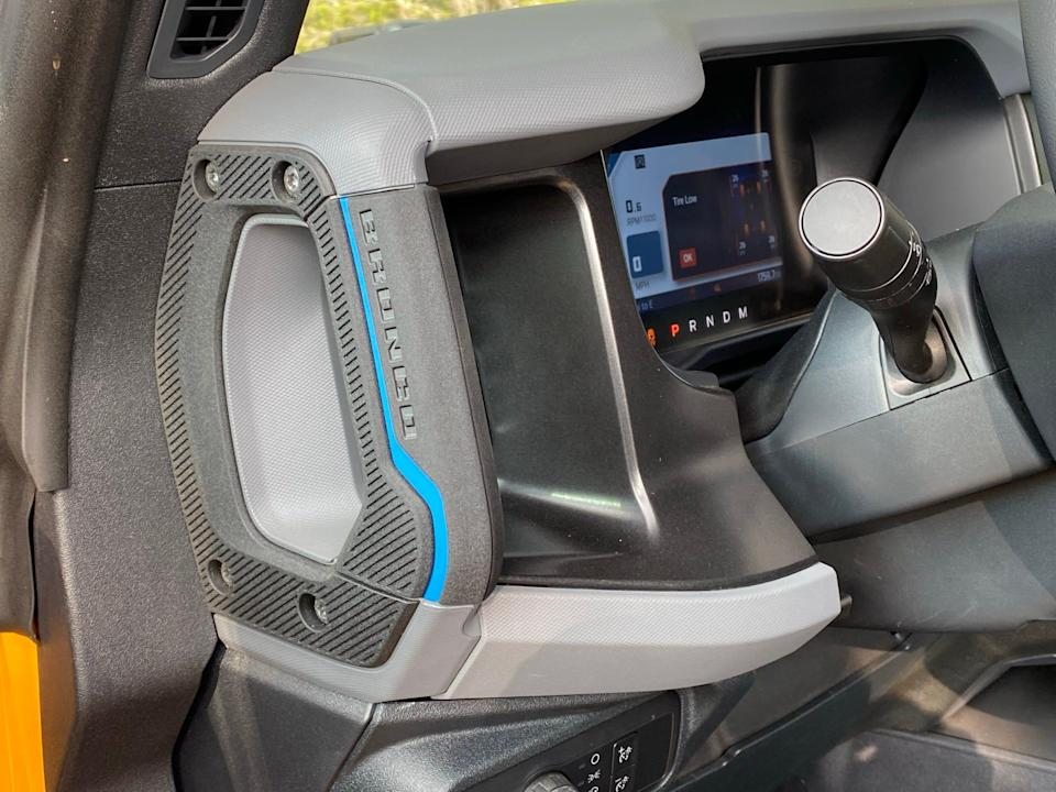 Dashboard-mounted grab handles in the 2020 Ford Bronco don't provide a lot of leverage for stepping up into the high SUV.