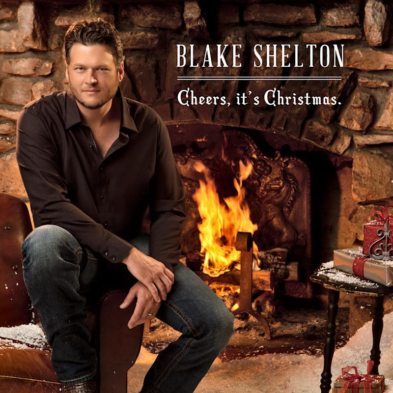 """This CD cover image released by Warner Bros., shows the holiday release by Blake Shelton, """"Cheers, It's Christmas."""" (AP Photo/Warner Bros.)"""