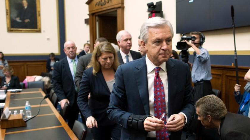 Going, going, gone: Then-Wells Fargo Chairman and CEO John Stumpf leaves a congressional hearing room after a flaying last month.