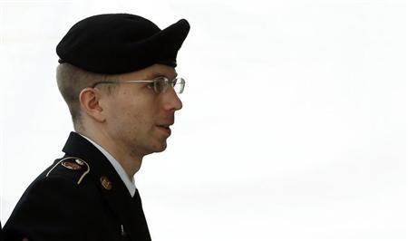 U.S. soldier Manning is escorted into court to receive his sentence at Fort Meade in Maryland