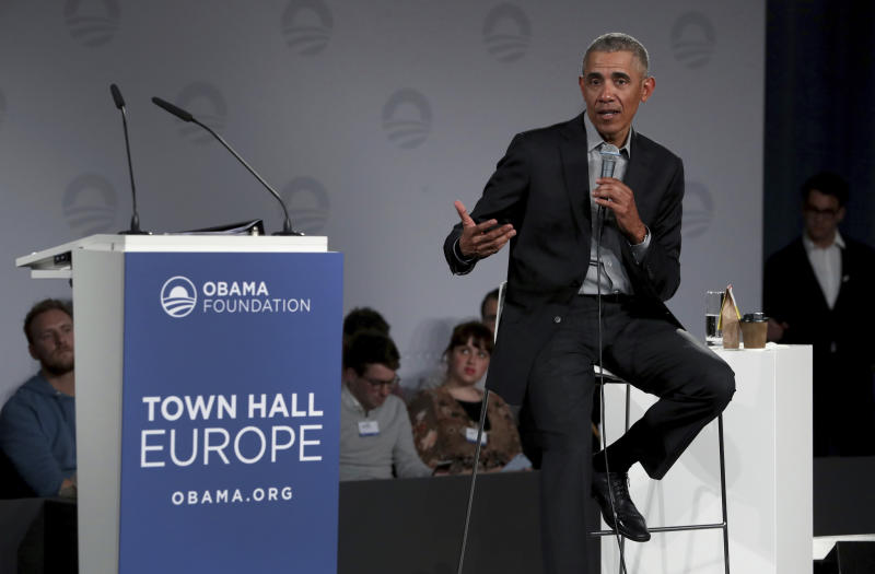 "FILE - In this April 6, 2019 file photo, former U.S. President Barack Obama speaks during a town hall meeting at the ""European School For Management And Technology"" (ESMT) in Berlin, Germany. On Friday, May 24, 2019, The Associated Press has found that stories circulating on the internet that Obama recently traveled to China, which just met with Iran and discussed their nuclear deal, are untrue. (AP Photo/Michael Sohn)"