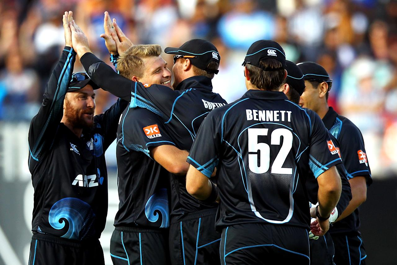 AUCKLAND, NEW ZEALAND - JANUARY 25: Corey Anderson of New Zealand celebrates with Martin Guptill after taking the wicket of Shikhar Dhawan of India during the One Day International match between New Zealand and India at Eden Park on January 25, 2014 in Auckland, New Zealand.  (Photo by Anthony Au-Yeung/Getty Images)