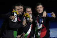 Italy Sabre team takes a selfie on the podium celebrating won the silver medal during the medal ceremony for the men's individual Sabre team final medal competition at the 2020 Summer Olympics, Wednesday, July 28, 2021, in Chiba, Japan. (AP Photo/Hassan Ammar)
