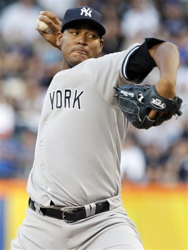 New York Yankees' Ivan Nova delivers a pitch during the first inning of an interleague baseball game against the New York Mets, Saturday, June 23, 2012, in New York. (AP Photo/Frank Franklin II)