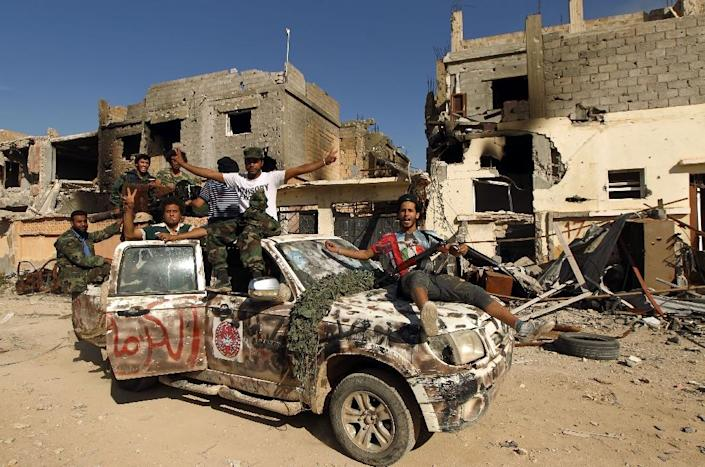 For two years the Libyan city of Benghazi has seen battles between loyalist forces, pictured, and armed groups including IS and Ansar al-Sharia, which is close to Al-Qaeda (AFP Photo/Abdullah Doma)
