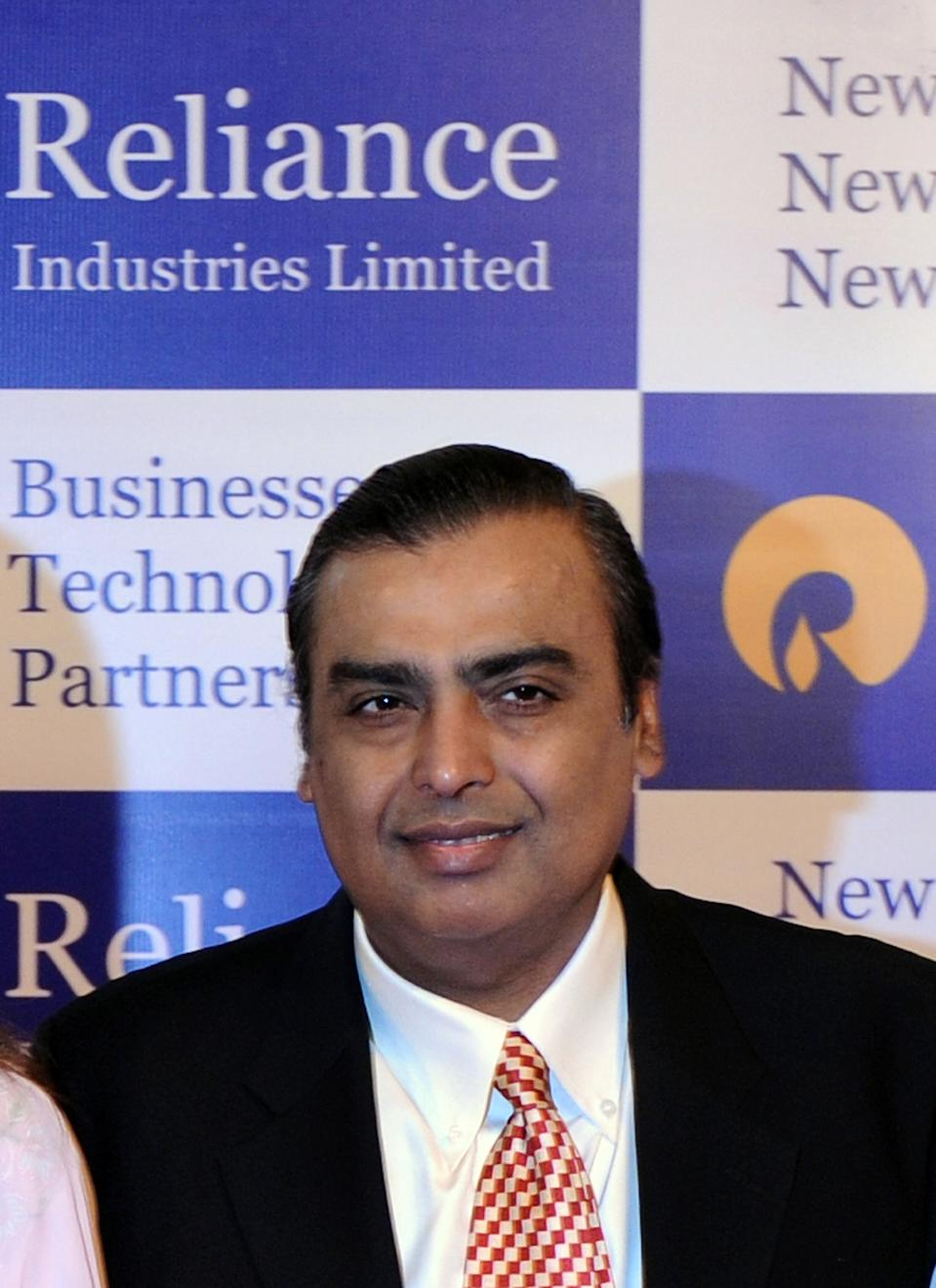 "Reliance Industries Chairman Mukesh Ambani poses on his arrival at the company's annual general meeting in Mumbai on June 3, 2011. India's largest private firm Reliance Industries plans to become completely debt-free in the financial year, its chairman Mukesh Ambani announced. Ambani, India's richest man, said Reliance planned to ""significantly enhance its ranking amongst global businesses"" as economic growth expands in India, with an aim to ramp-up its existing oil and gas and retail businesses further. AFP PHOTO/ Indranil MUKHERJEE"