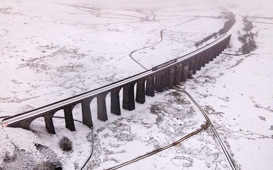 Heavy snow blanketed Ribblehead Viaduct in Yorkshire on Thursday - JAMES SPEAKMAN/MERCURY PRESS