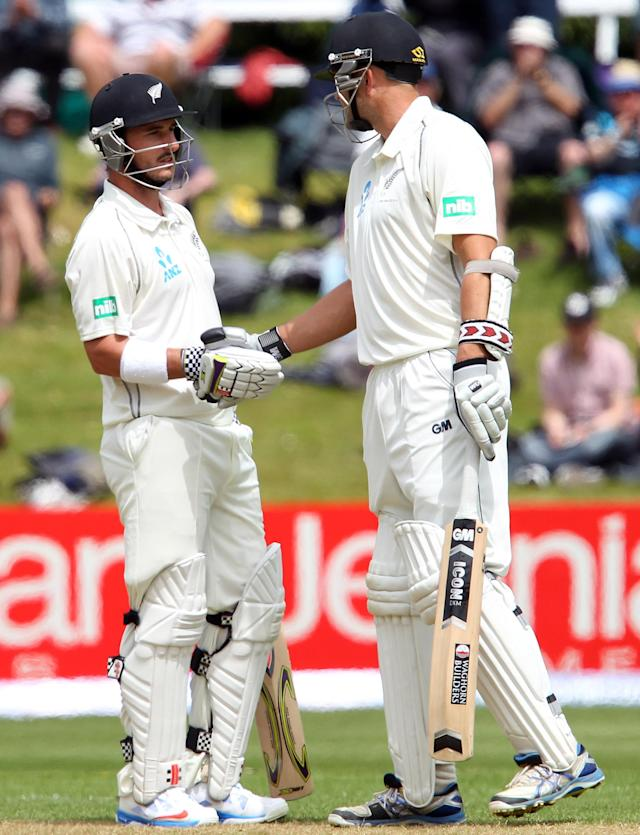 DUNEDIN, NEW ZEALAND - DECEMBER 03: Hamish Rutherford of New Zealand is congratulated on scoring 50 runs by Peter Fulton during day one of the first test match between New Zealand and the West Indies at University Oval on December 3, 2013 in Dunedin, New Zealand. (Photo by Rob Jefferies/Getty Images)