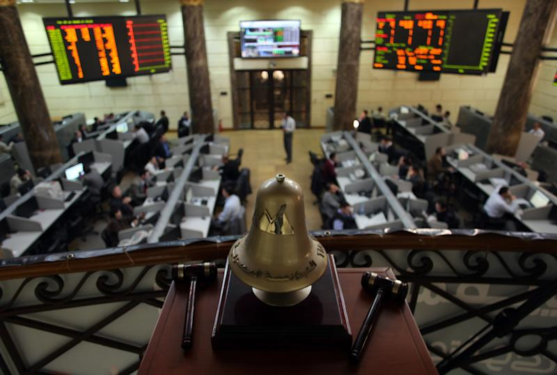 FILE - In this Wednesday, Jan. 2, 2013 file photo, Egyptian brokers work at the stock market in Cairo, Egypt. As Egypt begins the latest round of talks with the International Monetary Fund for a $4.8 billion loan, the government says it will boost international confidence in its economy. However, critics question whether the president's Muslim Brotherhood group has the ability to carry out unpopular austerity measures ahead of crucial parliamentary elections that will take place in the coming months. (AP Photo/Khalil Hamra, File)