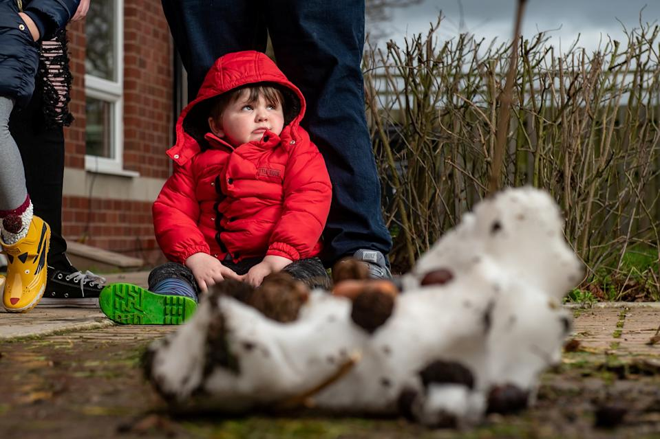 Three-year-old Joseph Taylor was left in floods of tears after watching a grinning binman boot the head off his 6ft-tall snowman (SWNS)