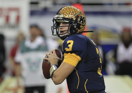 Kent State quarterback Spencer Keith (3) looks for a receiver during the first quarter of the Mid-American Conference championship NCAA college football game against Northern Illinois, Friday, Nov. 30, 2012. (AP Photo/Carlos Osorio)