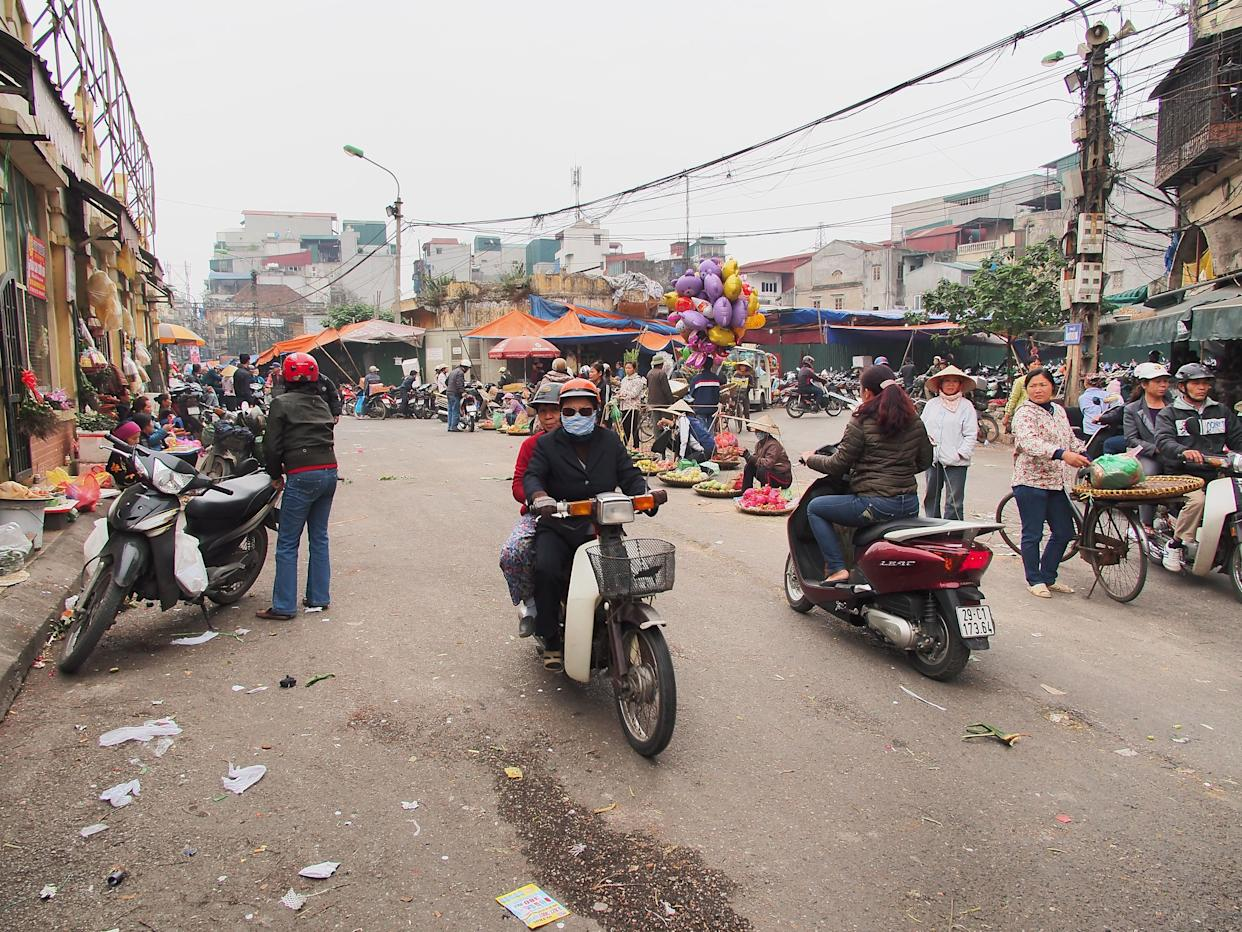 A motorcyclist wears a mask to block the smog in Hanoi. (Photo: Michael Hamrah via Getty Images)