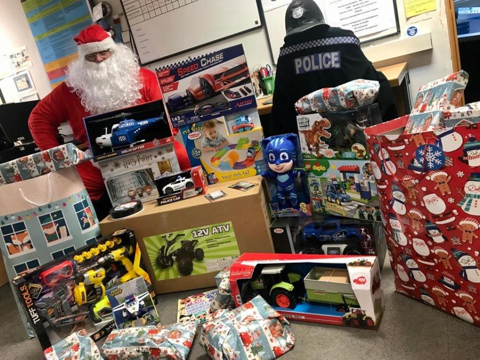 An officer from Durham Constabulary with the horde of presents. (Durham Constabulary)