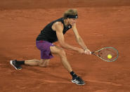 Germany's Alexander Zverev plays a return to Japan's Kei Nishikori during their fourth round match on day 8, of the French Open tennis tournament at Roland Garros in Paris, France, Sunday, June 6, 2021. (AP Photo/Michel Euler)