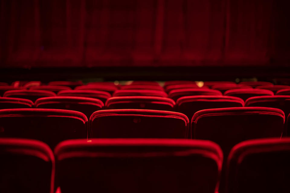 Red seats and curtains of an empty theater