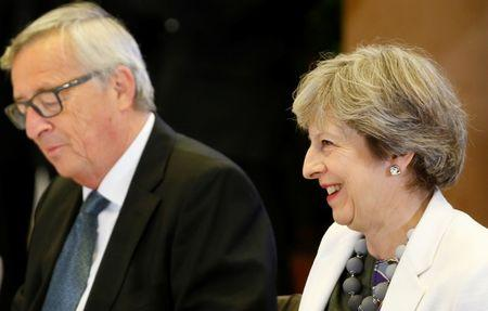 European Commission President Jean-Claude Juncker and British Prime Minister Theresa May take part in an EU summit in Brussels
