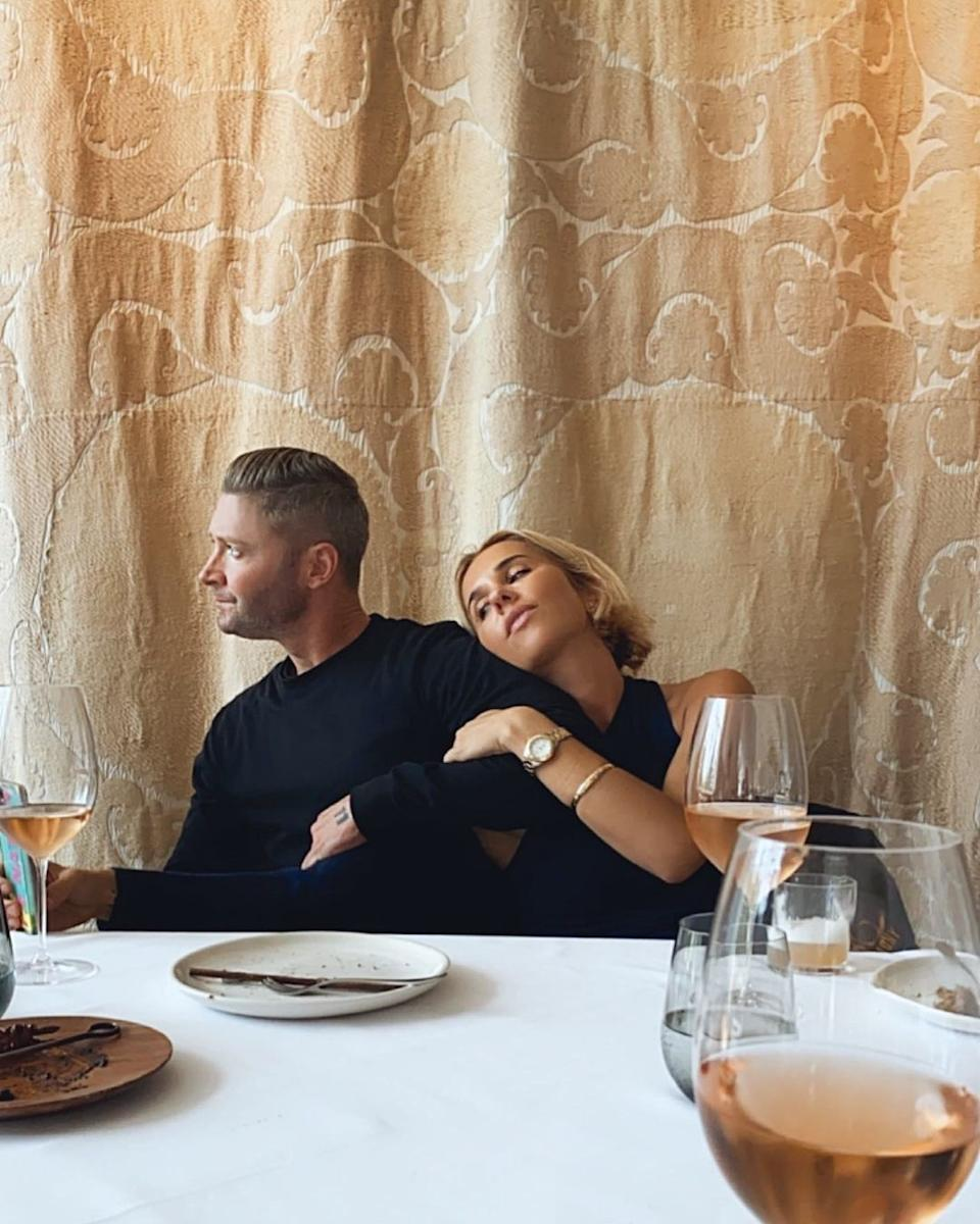 Fashion designer Pip Edwards and Aussie cricketer Michael Clarke sitting at a dinner table in a up scale restaurant