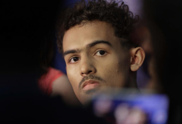 Trae Young, center, from Oklahoma, listens to a question during the interview segment at the NBA draft basketball combine Friday, May 18, 2018, in Chicago. (AP Photo/Charles Rex Arbogast)