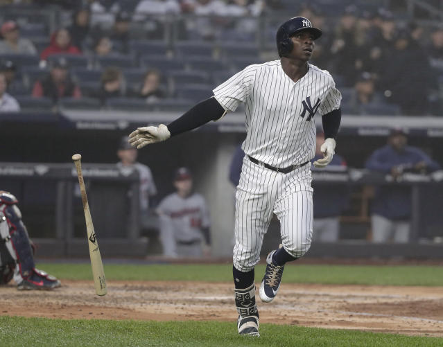 New York Yankees' Didi Gregorius watches his solo home run against the Minnesota Twins sail over the right field wall during the third inning of a baseball game, Wednesday, April 25, 2018, in New York. (AP Photo/Julie Jacobson)