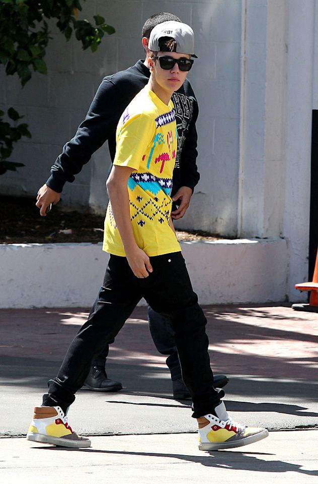 Fellow pop star Justin Bieber unsuccessfully attempted to look like a  tough guy -- in a backwards baseball cap and bad boy pout -- while out  and about in Beverly Hills earlier this week. Those digitized flamingos  on his T-shirt definitely elevate his street cred. (4/10/2012)