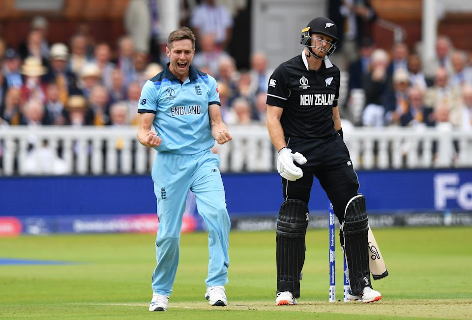 LONDON, ENGLAND - JULY 14: Chris Woakes of England celebrates dismissing Martin Guptill of New Zealand during the Final of the ICC Cricket World Cup 2019 between New Zealand and England at Lord's Cricket Ground on July 14, 2019 in London, England. (Photo by Mike Hewitt/Getty Images)
