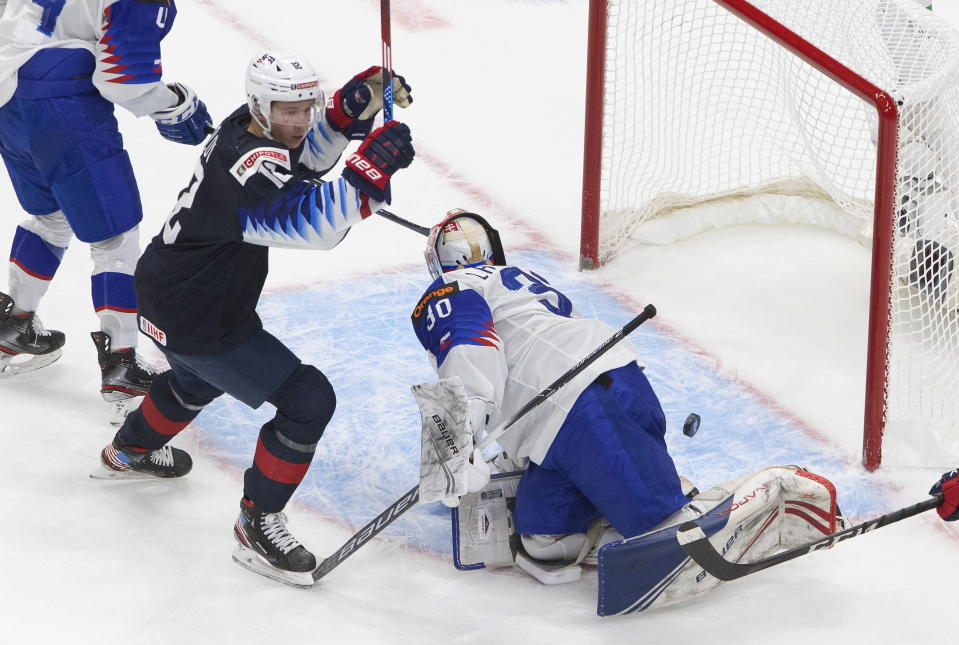 United States' Matthew Boldy (12) reacts as the puck go in past Slovakia goalie Simon Latkoczy (30) during the second period of an IIHL World Junior Hockey Championship game, Saturday, Jan. 2, 2021 in Edmonton, Alberta. (Jason Franson/The Canadian Press via AP)