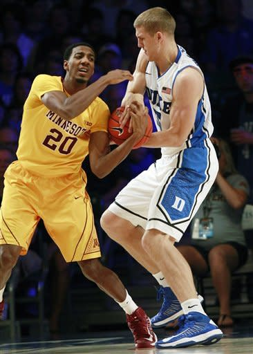Duke forward Mason Plumlee (5) and Minnesota guard Austin Hollins (20) fight for a loose ball in the first half of an NCAA college basketball game at the Battle 4 Atlantis tournament, Thursday, Nov. 22, 2012, in Paradise Island, Bahamas. (AP Photo/John Bazemore)