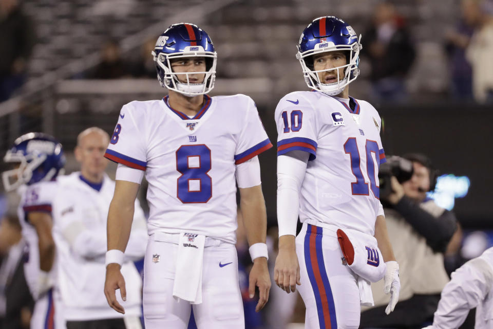 FILE - In this Nov. 4, 2019, file photo, New York Giants quarterback Daniel Jones (8) and quarterback Eli Manning (10) warm up before an NFL football game against the Dallas Cowboys, in East Rutherford, N.J. Giants quarterback Daniel Jones was kept out of practice Wednesday, Dec. 4, 2019, with a high right ankle sprain, and coach Pat Shurmur says Eli Manning very likely will start Monday night against the Philadelphia Eagles. Shurmur adds that Manning could very well be the starter for the rest of the season. (AP Photo/Adam Hunger, File)